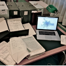 computer and research papers on a desk